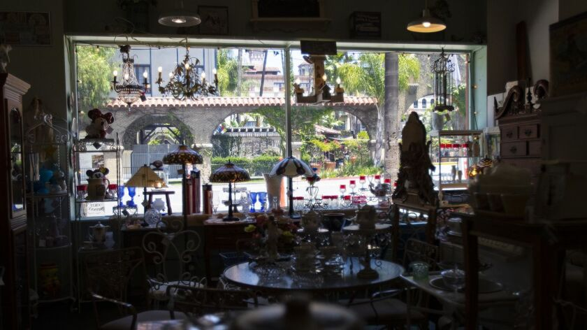 RIVERSIDE, CA - JUNE 22, 2019: The historic Mission Inn can be seen through the large picture window
