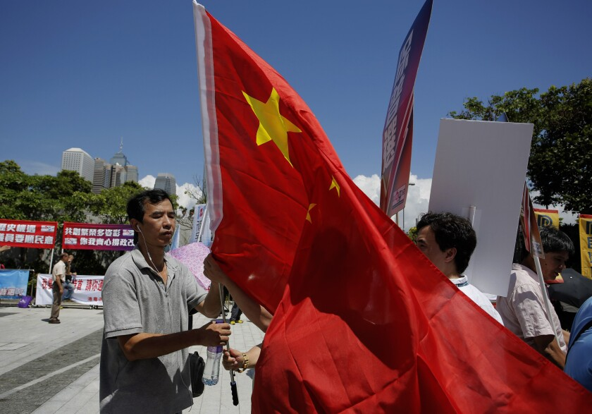 Pro-Beijing supporters display a Chinese national flag outside the Legislative Council in Hong Kong.