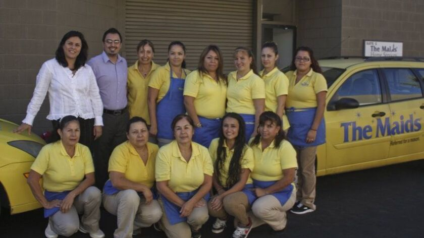 The Maids of San Diego crew takes a break to pose for a company photo. Reach The Maids of San Diego Cleaning Services at (858) 578-6243, (800) 843-6243 or maids.com