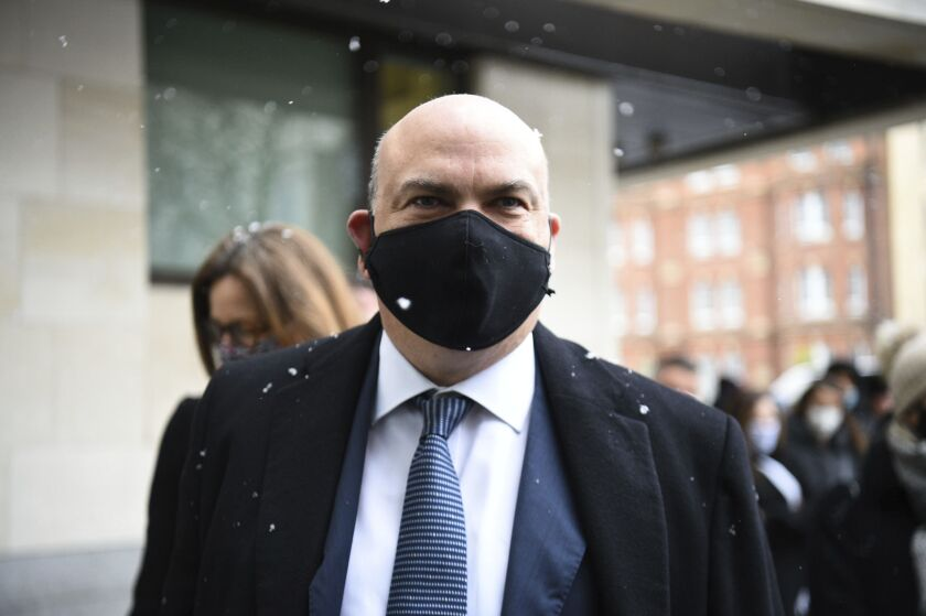 British tech tycoon Michael Lynch arrives at Westminster Magistrates' Court, London, Tuesday, Feb. 8, 2021. A British tech entrepreneur appeared in a London court Tuesday to fight extradition to the United States on fraud charges stemming from his firm's takeover by Hewlett-Packard. U.S. prosecutors say Michael Lynch inflated the value of his software company, Autonomy, before it was bought by Hewlett-Packard for $11 billion in 2011. (Kirsty O'Connor/PA via AP)