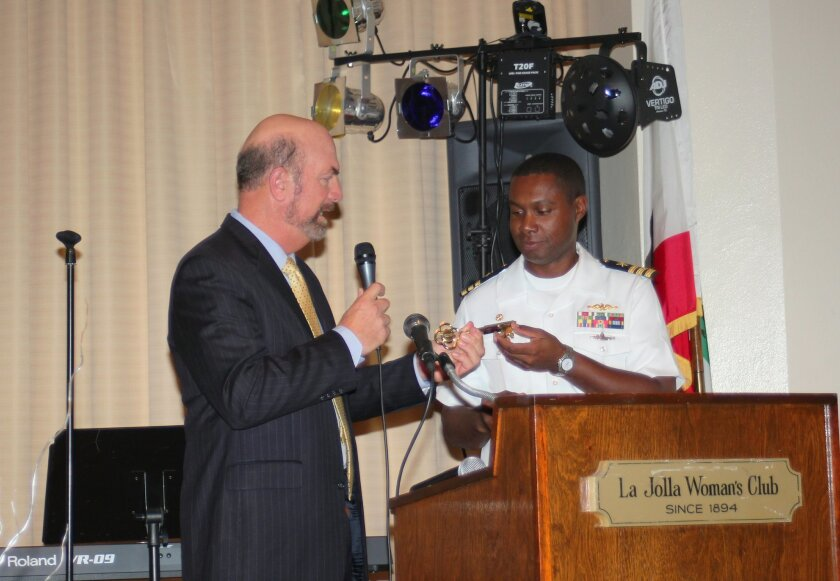 Town Council President Steve Haskins offers the USS La Jolla's commanding officer Kevin Roach the 'Key to the Village of La Jolla.'