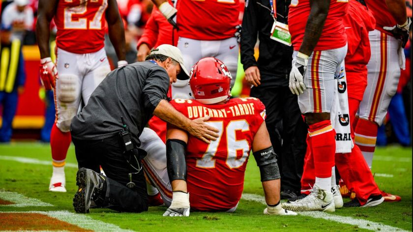 Laurent Duvernay-Tardif of the Chiefs is injured on a play against the Jaguars.