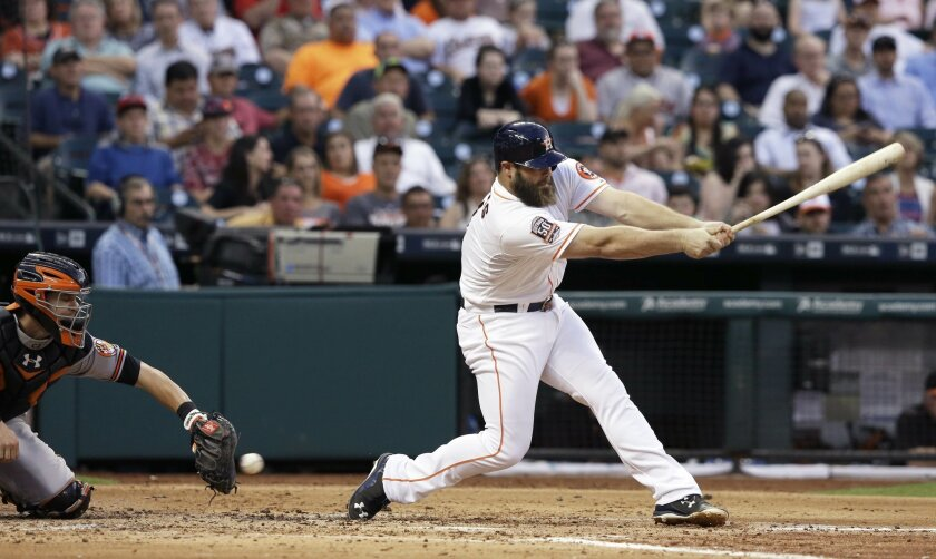 Houston Astros' Evan Gattis, right, swings for strike three as Baltimore Orioles catcher Caleb Joseph reaches for the ball in the fourth inning of a baseball game Monday, June 1, 2015, in Houston. (AP Photo/Pat Sullivan)