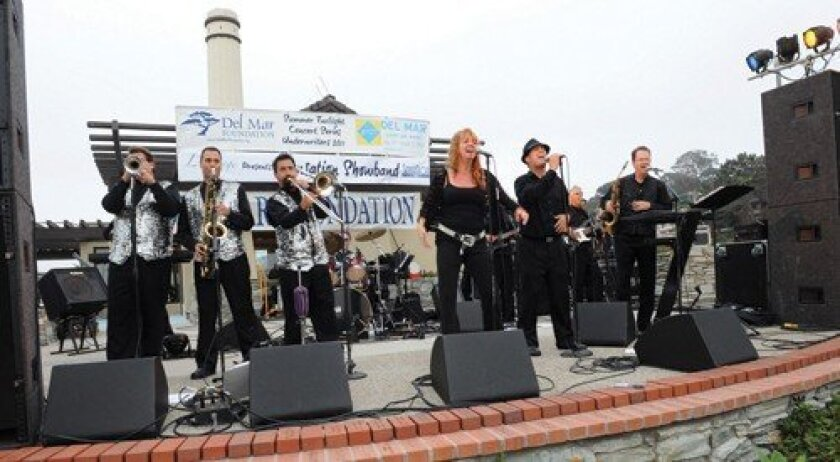 Sensation Showband performed the final show of the summer's Twilight Concert Series at Powerhouse Park. (Photo: Jon Clark)