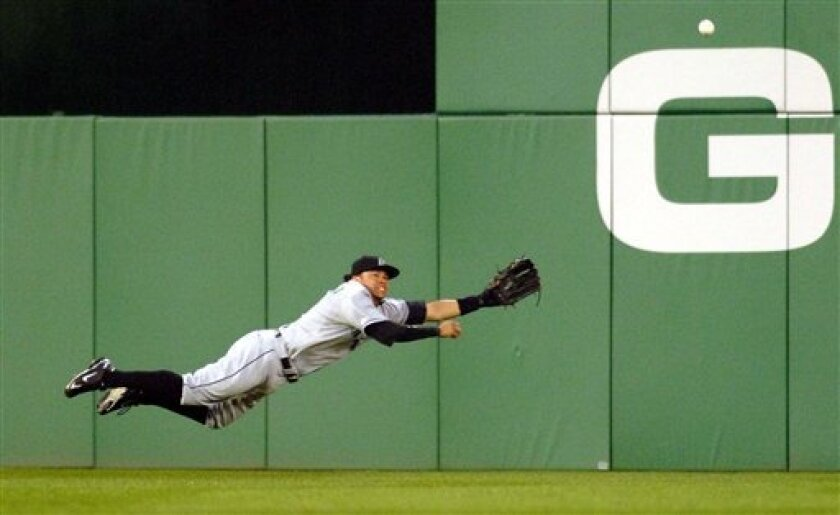 Florida Marlins' Alfredo Amezaga dives for a hit by Washington Nationals Cristian Guzman during the first inning of an MLB baseball game on Monday, April 7, 2008 in Washington. (AP Photo/Kevin Wolf)