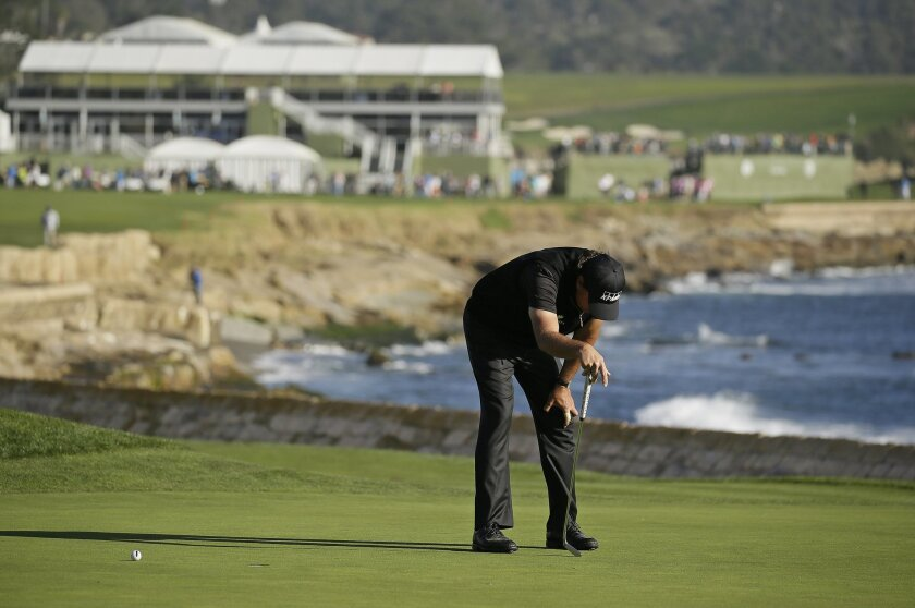 Phil Mickelson reacts after missing a birdie putt on the 18th green of the Pebble Beach Golf Links during the final round of the AT&T Pebble Beach National Pro-Am golf tournament Sunday, Feb. 14, 2016, in Pebble Beach, Calif. Vaughn Taylor won the tournament by one stroke over Mickelson. (AP Photo/
