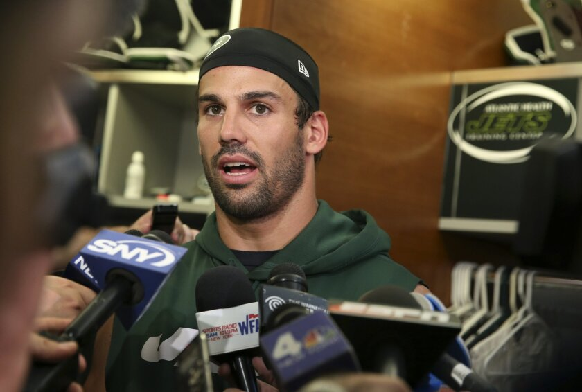 New York Jets wide receiver Eric Decker answers a question as he stands in the locker room after NFL football practice Wednesday, June 1, 2016, in Florham Park, N.J. (AP Photo/Mel Evans)