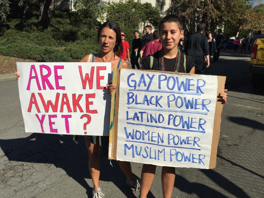 Berkeley residents Cristina Levert, and her daughter Soha, 17, spent Wednesday morning on the UC Berkeley campus protesting the election of Donald Trump as president.