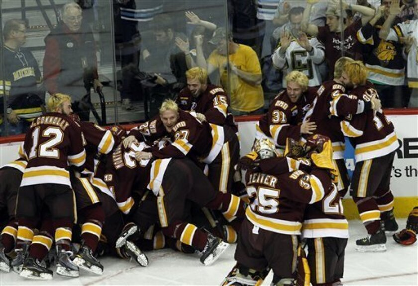 Minnesota Duluth players and fans celebrate after defeating Michigan 3-2 during overtime of the NCAA Frozen Four college hockey championship game in St. Paul, Minn., Saturday, April 9, 2011. (AP Photo/Ann Heisenfelt)