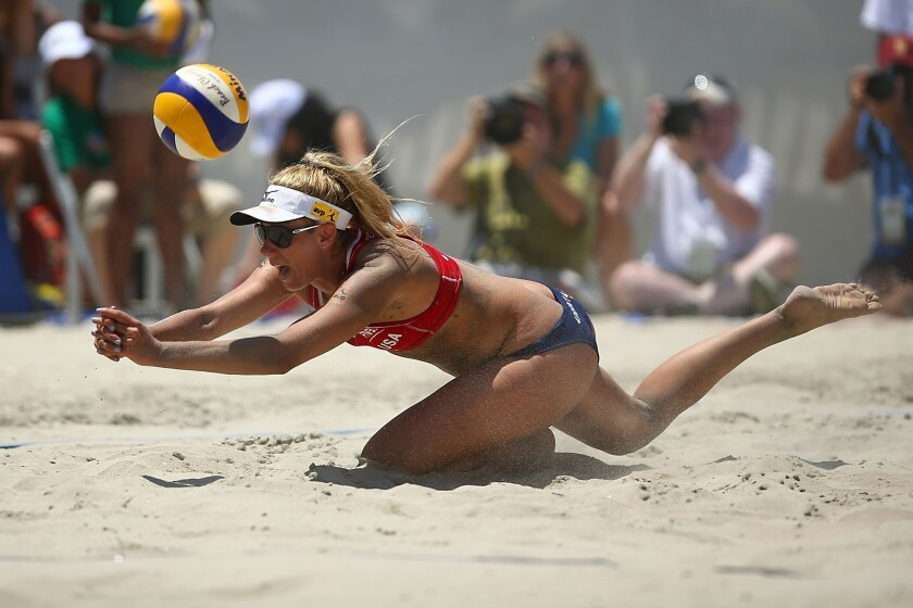 April Ross dives for the ball during a match at the FIVB Grand Slam in Long Beach on Saturday.