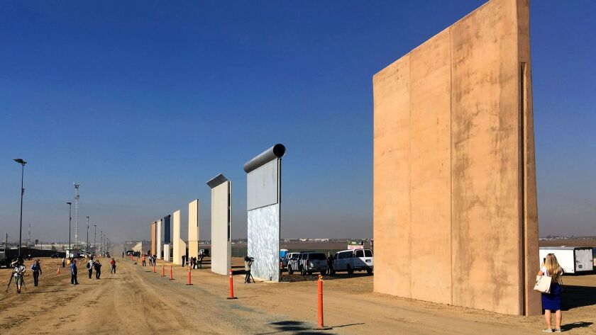 Prototypes of border walls in San Diego, seen in a file photo from October. President Trump plans to visit California in March and is likely to view the prototypes.