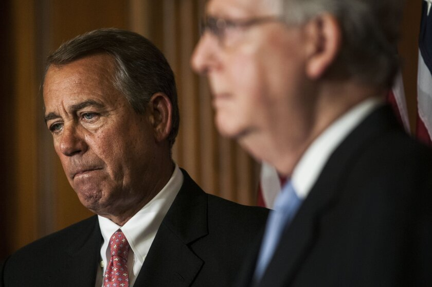 House Speaker John A. Boehner (R-Ohio), left, and Senate Majority Leader Mitch McConnell (R-Ky.) at the Capitol in Washington, D.C.