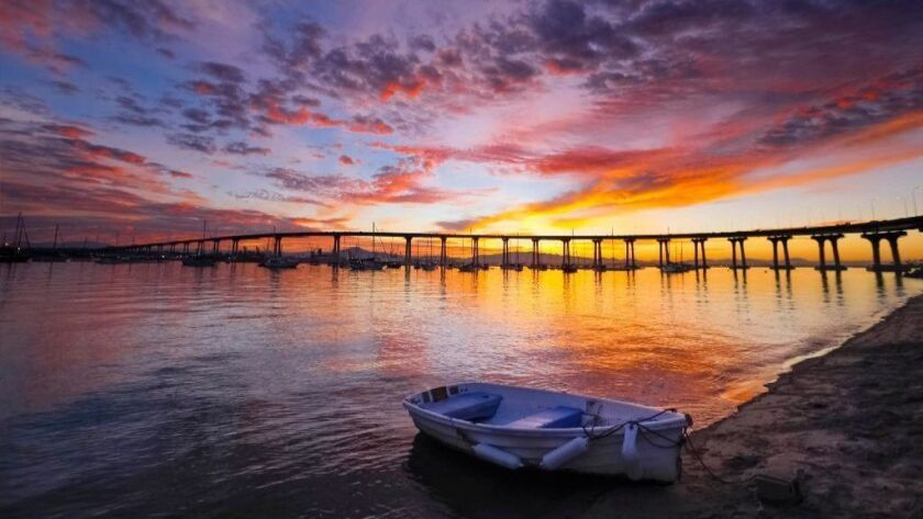 A row boat sits in the water at the launch area at Tidelands Park in Coronado.
