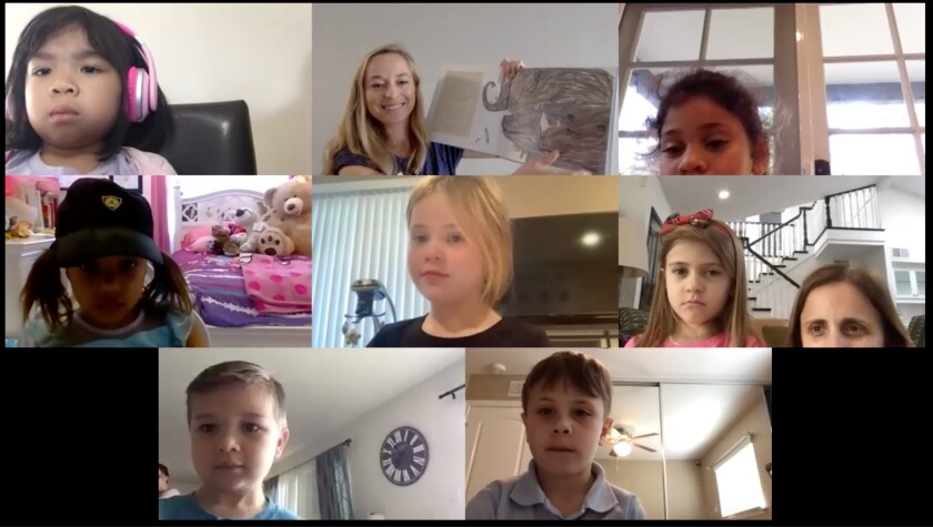 A group lesson is held on Zoom for transitional kindergartners from St. Bonaventure Catholic School in Huntington Beach whose class is being conducted online amid the coronavirus crisis.