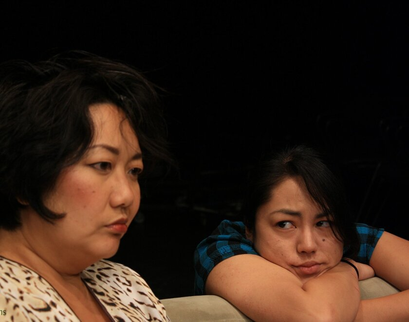 """Elise Kim Prosser and Carolyn Henderson as """"Isabel and Panny"""" in the play """"BFE"""" by the San Diego Asian American Repertory Theatre."""