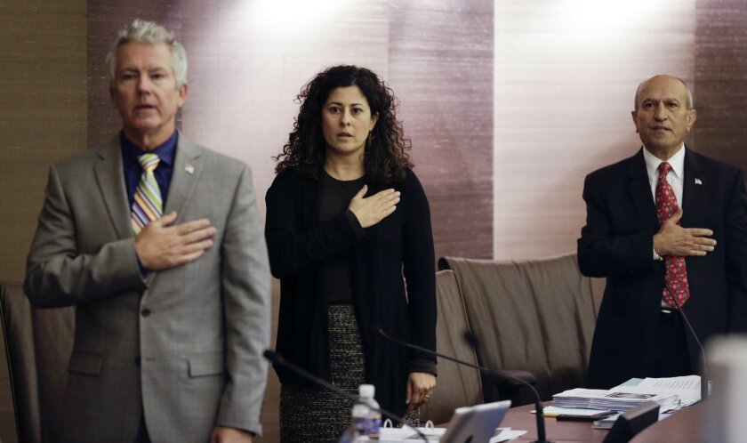 Olga Diaz (center) and Sam Abed (right) are running for mayor of Escondido