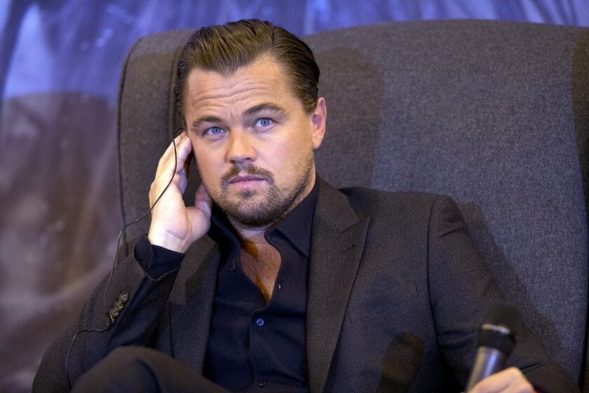 """FILE - In this Tuesday, Jan. 26, 2016 file photo, actor Leonardo DiCaprio listens to a question over a translation earpiece during a press event to promote his new film """"The Revenant,"""" in Mexico City. Residents of a town in Russia's Far East have been donating their gold and silver for something ne"""