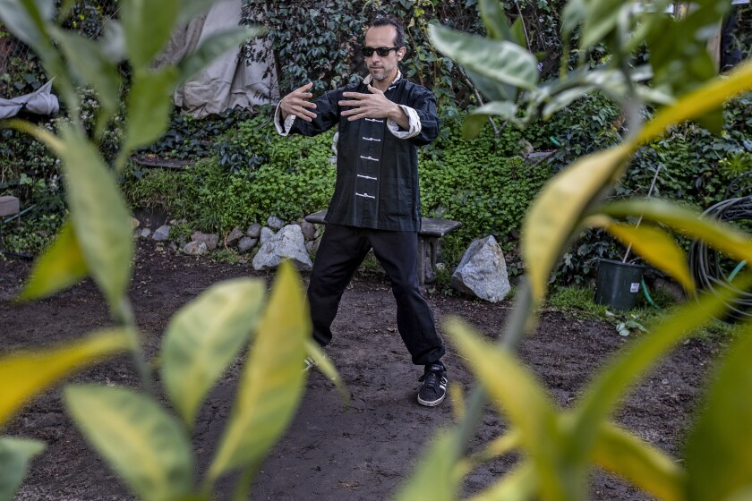 Paul Terry practices tai chi in his Inglewood garden.