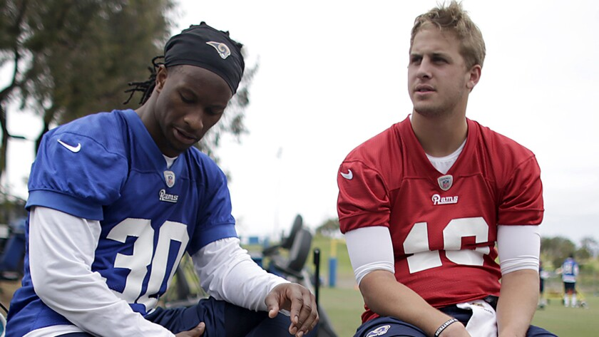Rams Todd Gurley and Jared Goff share a moment.