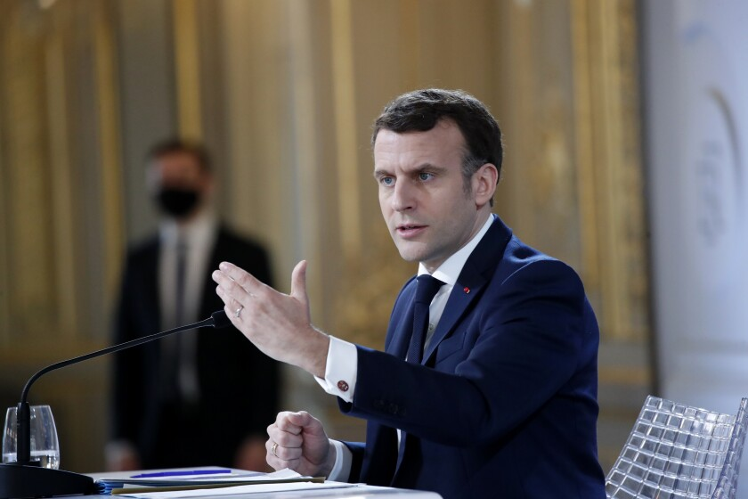 French President Emmanuel Macron delivers his speech after a meeting via video-conference with leaders of the G5 Sahel Tuesday, Feb. 16, 2021 in Paris. French President Emmanuel Macron urged West African leaders to step up efforts in the fight against Islamic extremists in the Sahel region both on the military and political fronts, with support from the international community. Macron joined by video from Paris a summit organized in N'Djamena, Chad with the leaders of Mali, Burkina Faso, Chad, Niger and Mauritania. (AP Photo/Francois Mori, Pool)
