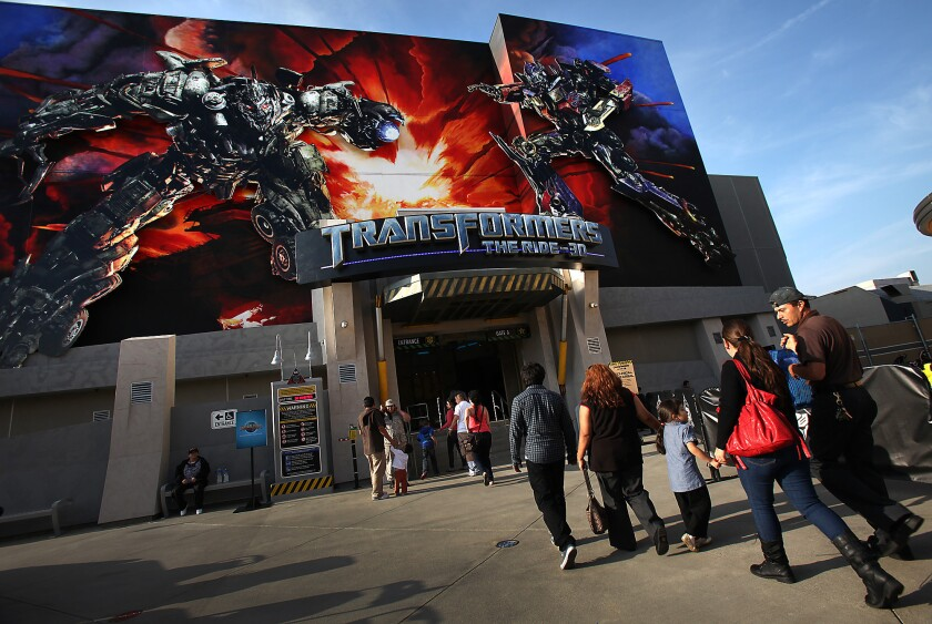 Guests walk into Transformers: The Ride 3D at Universal Studios Hollywood last year.