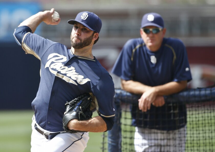 Padres starting pitcher Brandon Morrow throws under the supervision of Padres' pitching coach Darren Balsley prior to a baseball game against the San Francisco Giants Monday, July 20, 2015, in San Diego. Morrow is working his way back from the disabled list.