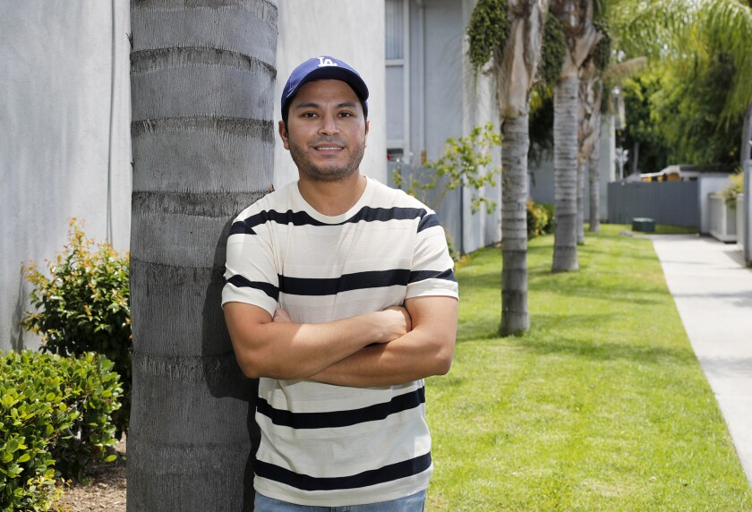 Cal State Fullerton student Oscar Flores, 29, of Anaheim is a public relations major who is entering into the job market after he graduates this spring. Flores is currently taking four virtual classes. Due to the coronavirus, he was laid off from an internship at a company that was going to extend his time until he got a job.