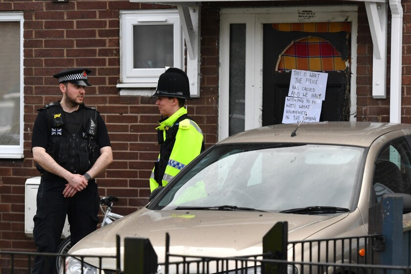 Police officers stand outside a property in Quantock Street in the Moss Side area of Manchester where a raid was carried out on May 28, 2017.