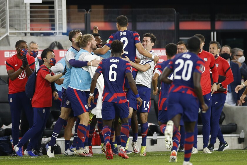 American Sergiño Dest celebrates with teammates after scoring against Costa Rica.