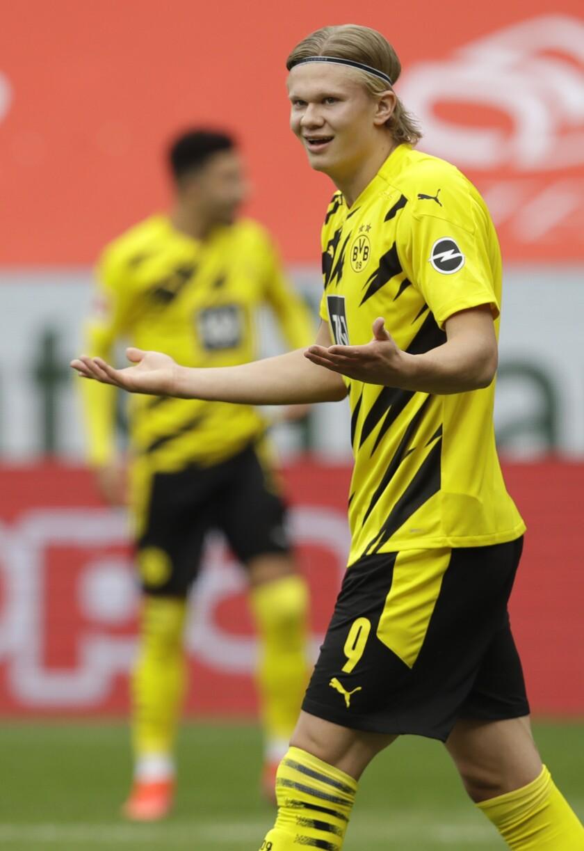 Dortmund's Erling Haaland reacts during the German Bundesliga soccer match between FSV Mainz 05 and Borussia Dortmund in Mainz, Germany, Sunday, May 16, 2021. (AP Photo/Michael Probst,Pool)