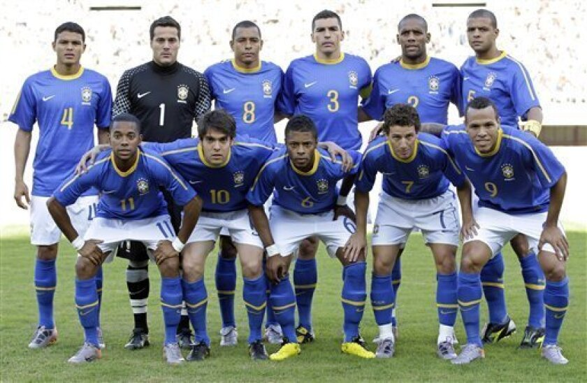 Brazil's national soccer team poses for a picture prior to the friendly match against Zimbabwe, in Harare, Zimbabwe, Wednesday, June 2, 2010. Back row from left: Thiago Silva, Julio Cesar, Gilberto Silva, Lucio, Maicon and Felipe Melo; Front row, from left: Robinho, Kaka, Michel Bastos, Elano and Luis Fabiano. Brazilian team is preparing for the upcoming South Africa World Cup, which gets underway on June 11. (AP Photo/Andre Penner)
