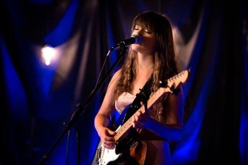 Encinitas singer/songwriter Kennady Tracy, 15, performs during the weekly open mic she hosts at The Studio.