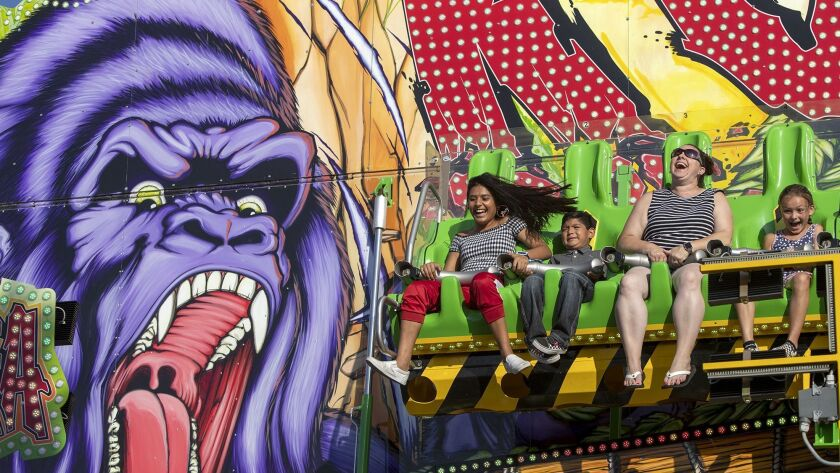 Fair goers ride the new ride Konga at the Orange County Fair on Thursday, July 26.