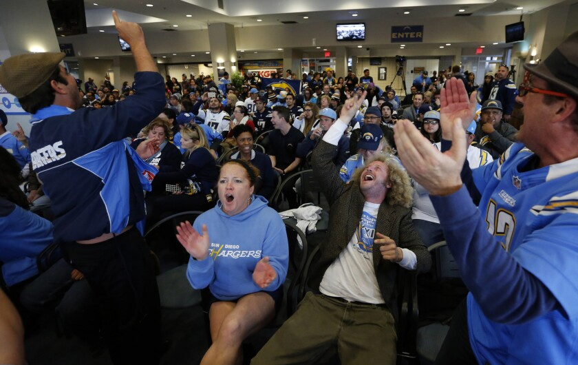 A group of San Diego Chargers season ticket holders whip up the crowd at a mayoral committee meeting at Qualcomm Stadium where some voiced their concerns about financing a new stadium for the football team.