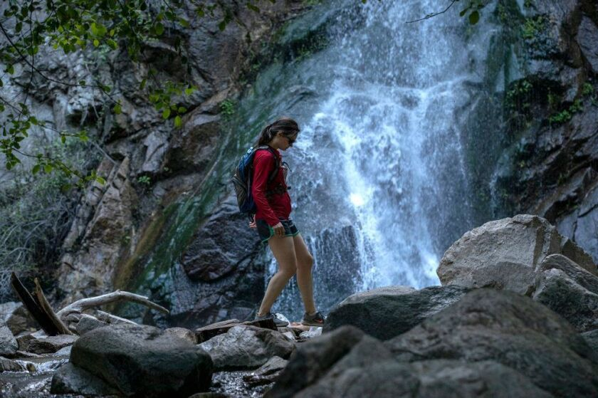 Samantha McArthy of Oconomowoc, Wisc., gingerly makes her way through Sturtevant Falls in Angeles National Forest.
