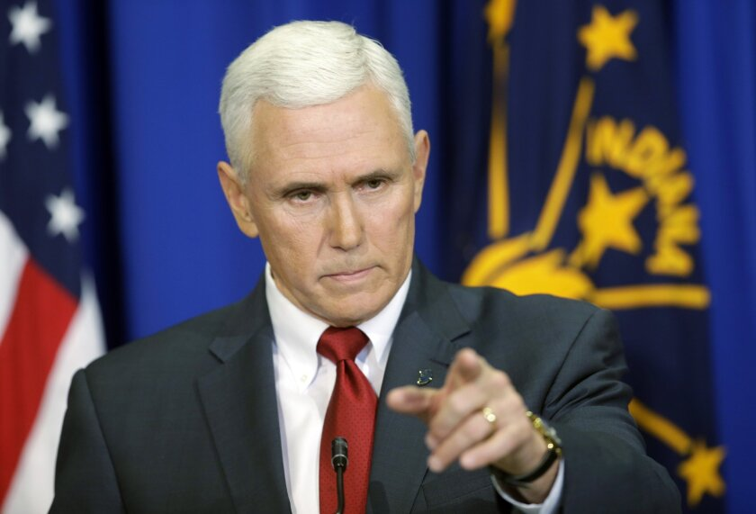 Indiana Gov. Mike Pence takes a question during a news conference Tuesday in Indianapolis. Pence said that he wants legislation on his desk by the end of the week to clarify that the state's new religious-freedom law does not allow discrimination against gays and lesbians.