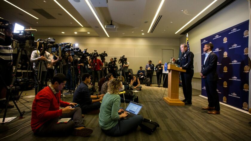 LAPD Assistant Chief Michel Moore addresses a room full of reporters Tuesday at the department's downtown headquarters.