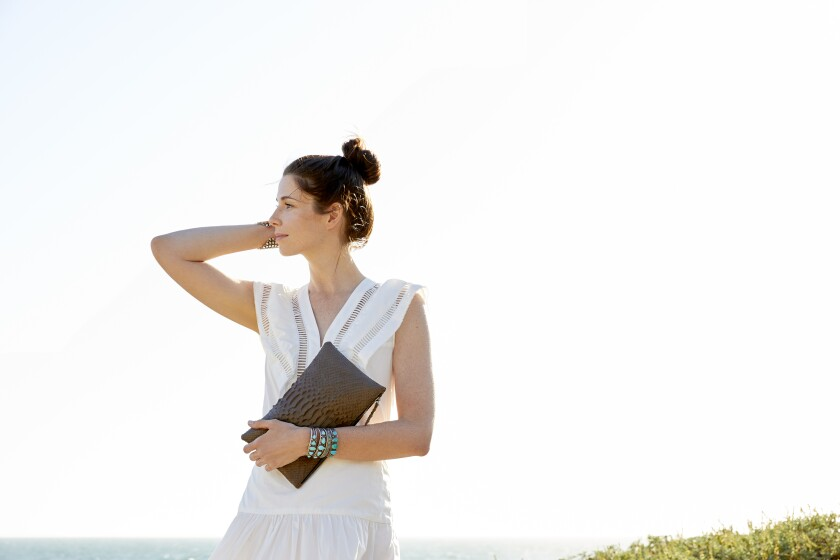 A model holds a bag from L.A. eco-chic travel accessories brand Rivers Eight.