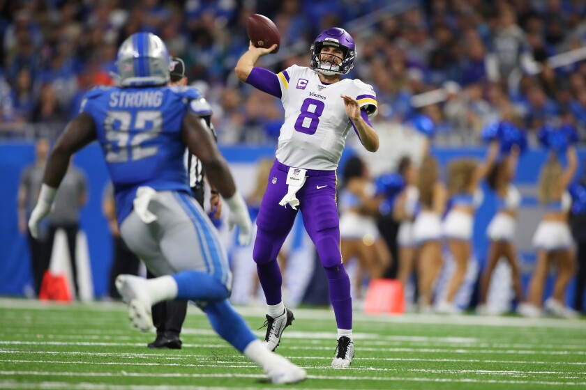 Minnesota Vikings quarterback Kirk Cousins throws a pass during the second half of Sunday's win over the Detroit Lions.