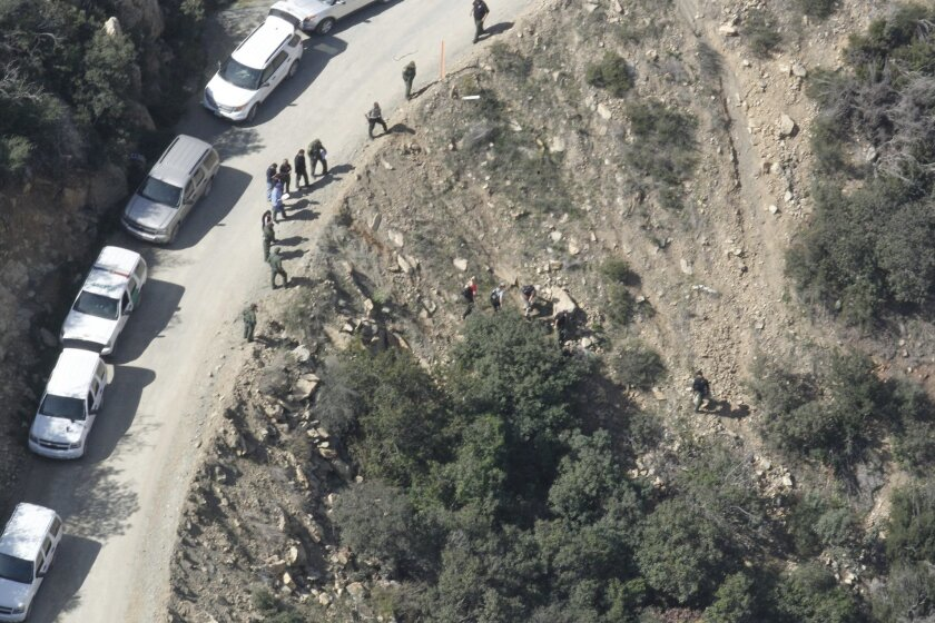 Investigators had to hike to an area in the Otay Mountains where a man was shot to death Tuesday by a Border Patrol agent.