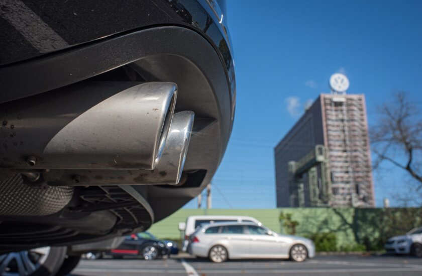 The exhaust pipe of a Volkswagen Passat pictured in front of the Volkswagen plant in Wolfsburg, Germany.