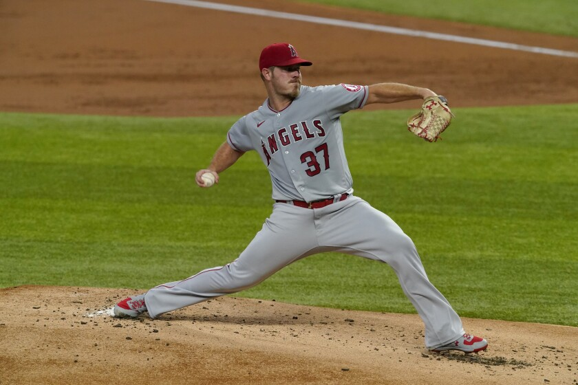 Angels pitcher Dylan Bundy throws to the Texas Rangers.
