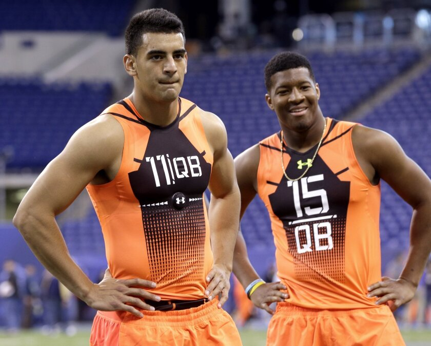 Marcus Mariota, left, and Jameis Winston put loss-of-value policies in the playbook. Both received such policies from their colleges in their final year.