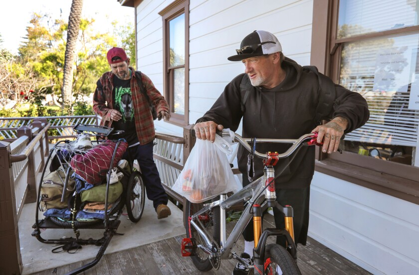 Travis Ramirez (left) and Donny Barker prepare to leave Magee Historical Park Friday morning.