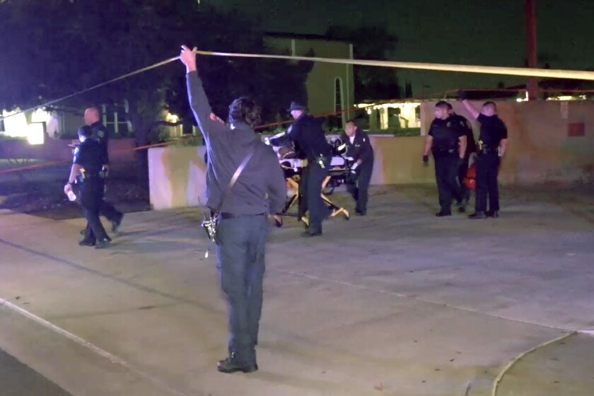 A man is transferred to an ambulance after a police shooting in Anaheim on Thursday night. He later died from his injuries.