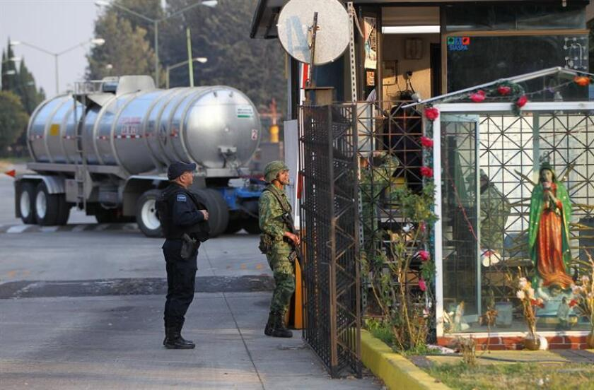 Army troops and Mexico City police officers guard a fuel distribution terminal on Jan. 14, 2019, in Mexico City, Mexico, as part of an operation to stop fuel theft. EPA-EFE FILE/Mario Guzman
