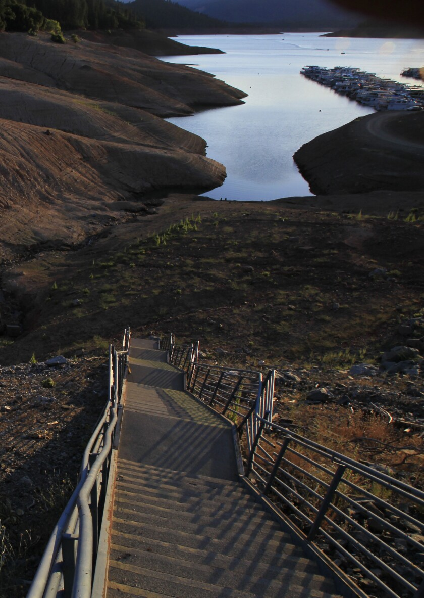 A long staircase leads to a dry lake bed as water recedes into Lake Shasta at sunset due to serious drought conditions. State lawmakers Wednesday approved a ballot measure for a $7.5 billion water bond that includes money for new reservoirs.