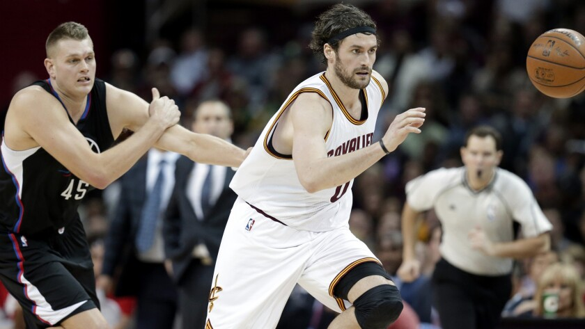 Clippers center Cole Aldrich (45), giving chase with Cavaliers forward Kevin Love for a loose ball, spent last season with the Knicks dealing with inclement winter weather.