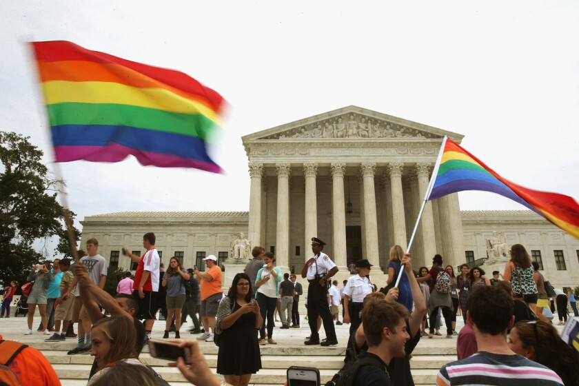 People celebrate in front of the U.S. Supreme Court after the ruling in favor of same-sex marriage in Washington, DC.