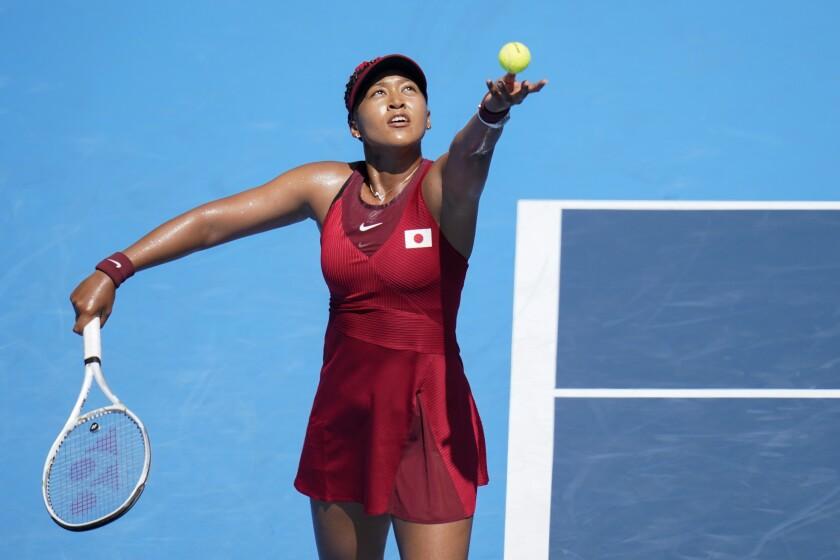 Naomi Osaka serves during her first-round win over Zheng Saisai.